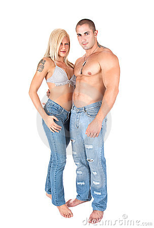 Young couple in jeans standing and posing