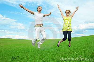 Young couple jump