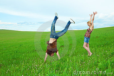 Young couple jump around in the nature