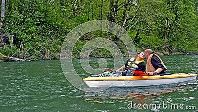 Young Couple Kiss While Kayaking