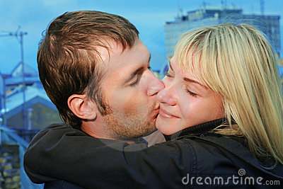 Young couple kissing on roof