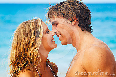 Young Couple Kissing on Tropical Beach