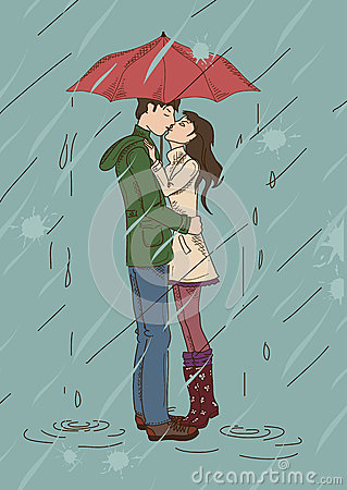 Young couple kissing under an umbrella