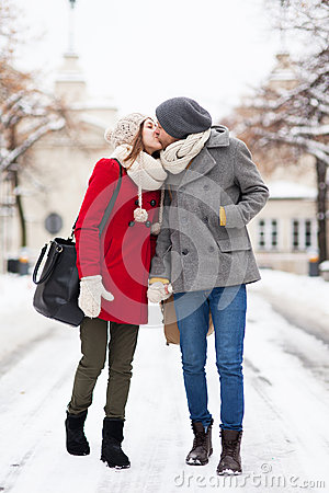 Young couple kissing on winter day
