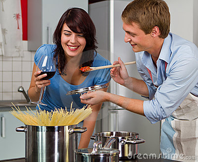Young couple in the kitchen cooking dinner