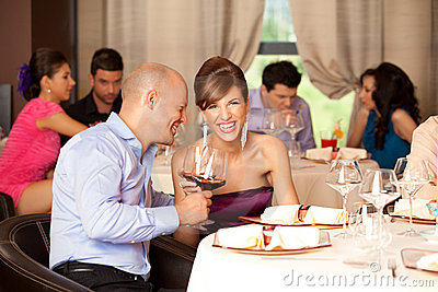 Young couple laughing  restaurant