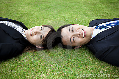 Young couple and lay on the grass