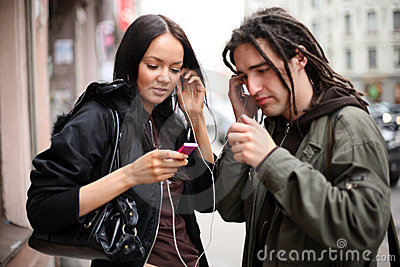 Young couple listening to music
