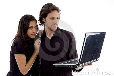 Young couple looking into laptop