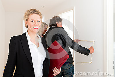 Young couple looking for real estate with realtor
