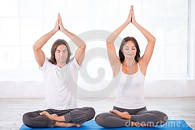 young couple in lotus pose stock photo  image 44670907