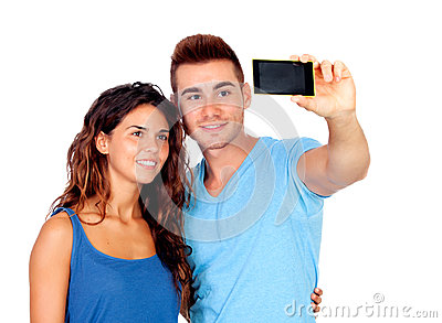 Young couple in love by becoming a photo with mobile