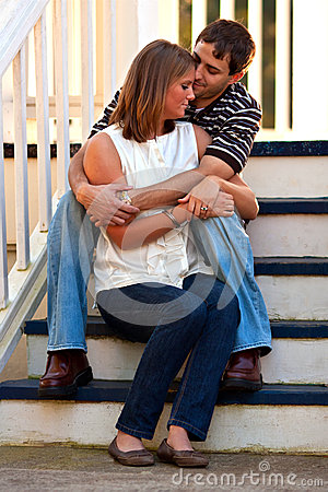 Young Couple In Love Embrace On Steps
