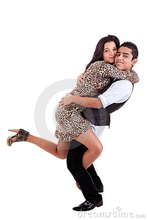 Young couple in love, hugging, man holding her