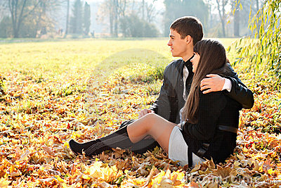 Young couple in love hugging in outdoors