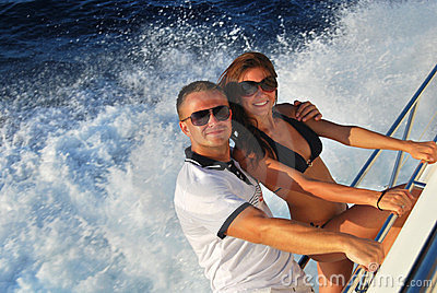 Young couple in love sailing  sailboat yacht