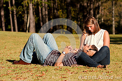 Young Couple In Love Share A Loving Moment In Park