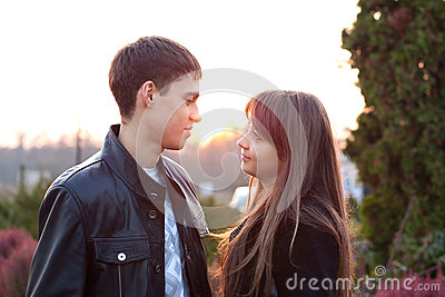 Young couple in love in sunny autumn outdoors
