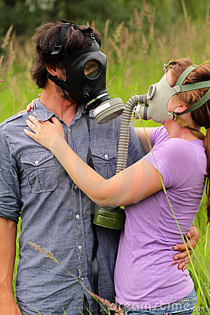 Young Couple in Love Wearing Gas Masks