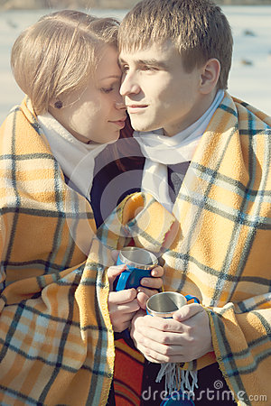 Young couple in love, winter drink tea