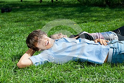 Young couple lying on the grass in park