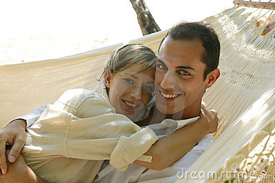 Young couple lying in hammock