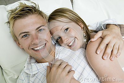 Young couple lying on sofa portrait close up