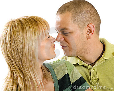 Young couple making faces to each other