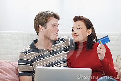 Young couple making online purchases