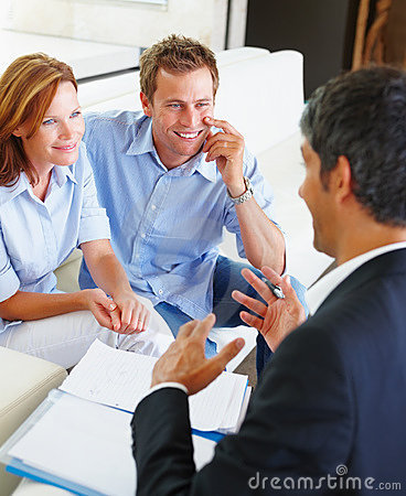 Young couple at meeting with a financial planner