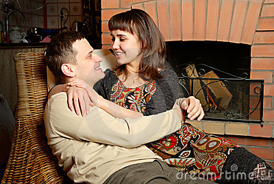 Young couple near fireplace