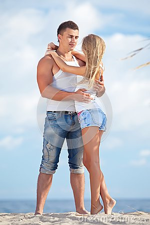 Free Young Couple On The Beach Stock Photography - 119698672