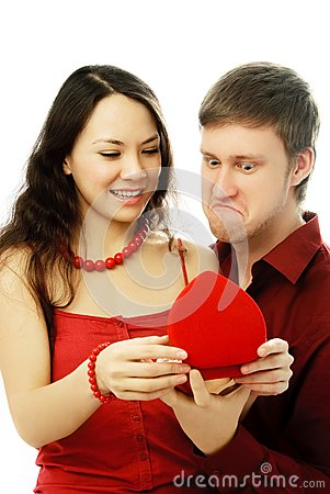 Young couple opening a present