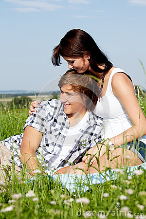 Young couple outdoor in summer on blanket