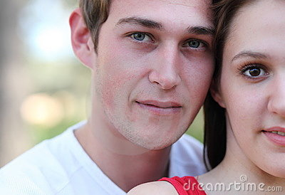 Young couple outdoors in a park