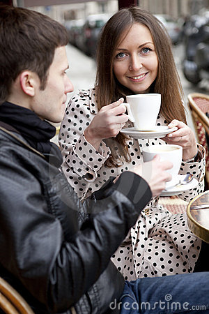 Young couple in a Parisian street cafe