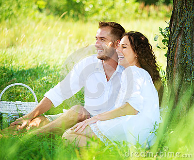 Young Couple in a Park. Picnic