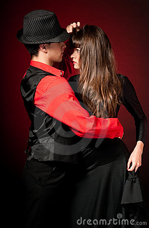 Young couple passion dancing on red light back