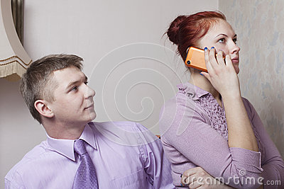 Young couple and phone.