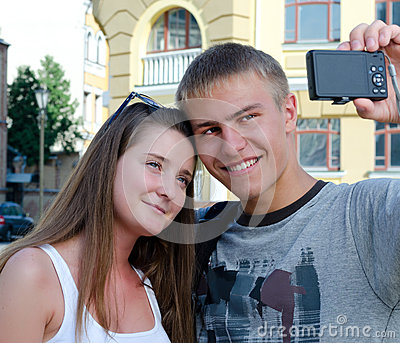 Young couple photographing themselves