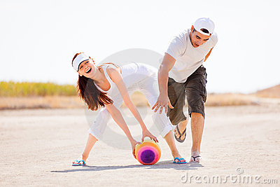 Young couple playing with ball