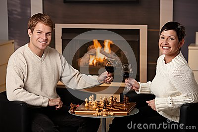Young couple playing chess