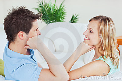 Young couple playing to look at each other