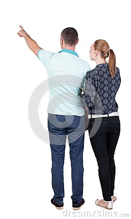 Free Young Couple Pointing At Wal Back View Stock Images - 44216514