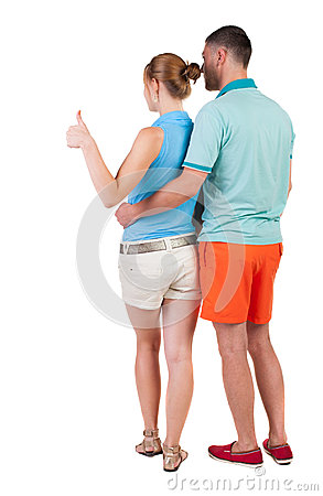Free Young Couple Pointing At Wal Back View Stock Image - 44216521