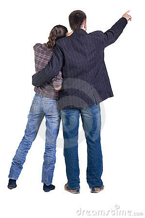 Young couple pointing at wall. Rear view.