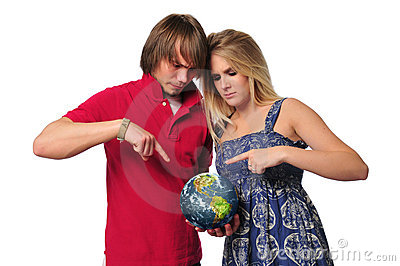 Young couple ponting to the earth