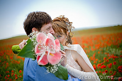 Young couple in poppy field