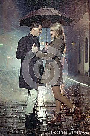 Free Young Couple Posing In Heavy Rain Stock Photo - 34465390