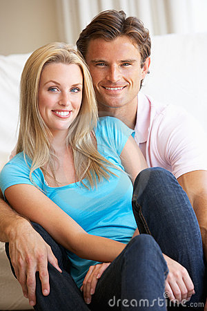 Young couple posing indoors
